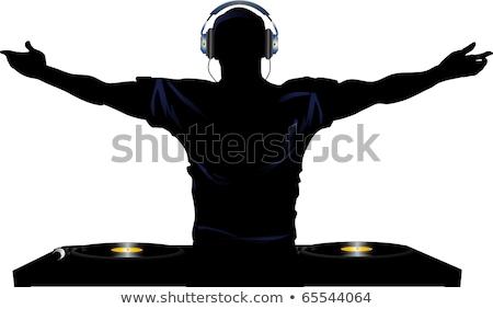 man dj wearing headphones Stock photo © stryjek