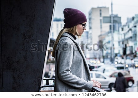 side profile of a young woman standing stock photo © bmonteny
