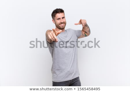Casual man facing towards the wall Stock photo © stockyimages