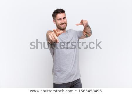 casual man facing towards the wall stock photo © stockyimages