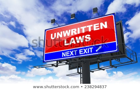 Unwritten Laws Inscription on Red Billboard. Stock photo © tashatuvango