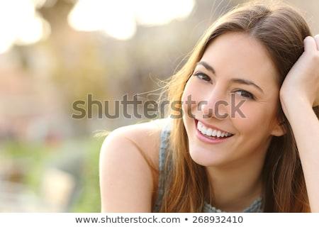 улыбаясь · довольно · модель · красивая · девушка · микрофона · продажи - Сток-фото © Dave_pot
