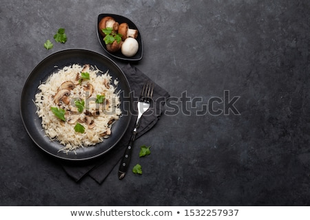 Risotto koken champignon maaltijd granen kruid Stockfoto © M-studio