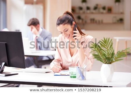 smiling businesswoman calling on smartphone stock photo © dolgachov