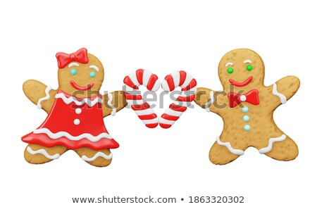 A gingerbread couple with christmas decorations Stock photo © Zerbor
