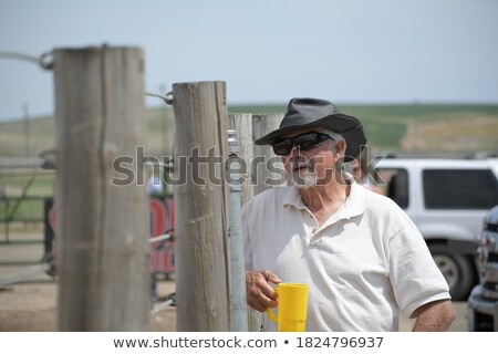 serious thoughtful senior casual man wearing hat and sunglasses stock photo © feedough