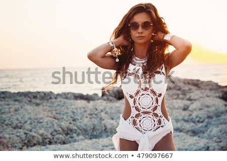 Woman in white bikini wearing sunglasses Stock photo © dash