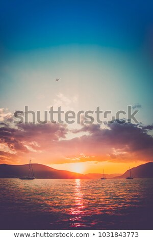 boat in a quiet bay at sunset Stock photo © morrbyte