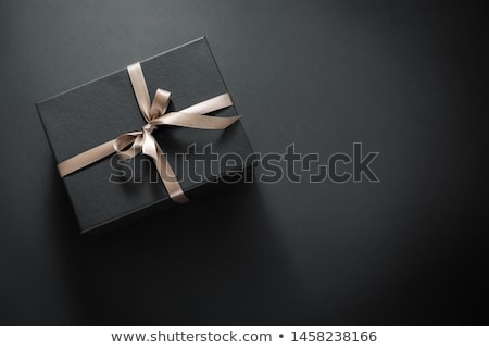 Stock photo: Christmas gifts on a black table