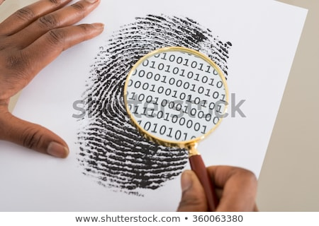 Person Using Magnifying Glass On Finger Print Stock photo © AndreyPopov