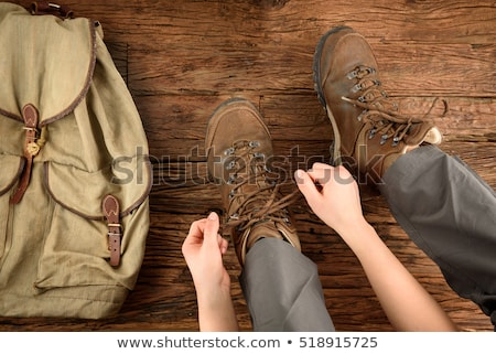 Stock photo: Hiking shoes - woman tying shoe laces