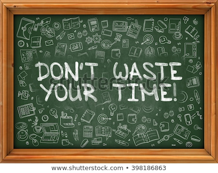 Don't Waste Your Time - Hand Drawn on Green Chalkboard. Stock photo © tashatuvango