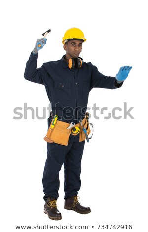 young african american carpenter holding a hammer stock photo © rastudio
