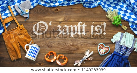 Beer mug on  background of  German flag. Fflag is a symbol of  O Stock photo © popaukropa
