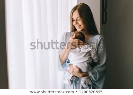 Nő hordoz baba otthon család szeretet Stock fotó © IS2