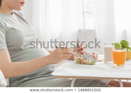Woman eating spoonful of supplements Stock photo © IS2
