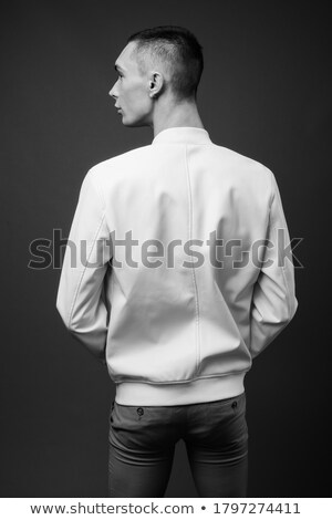 Androgynous man against grey background Stock photo © wavebreak_media