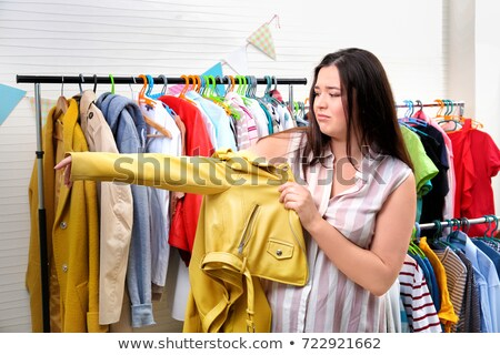 Sad overweight woman in fashionable clothes Stock photo © Traimak