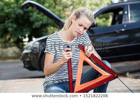 Güzel genç kadın güvenlik üçgen yol kenarı araba Stok fotoğraf © lightpoet