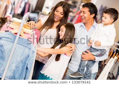 Family shopping in the clothes store Stock photo © Kzenon