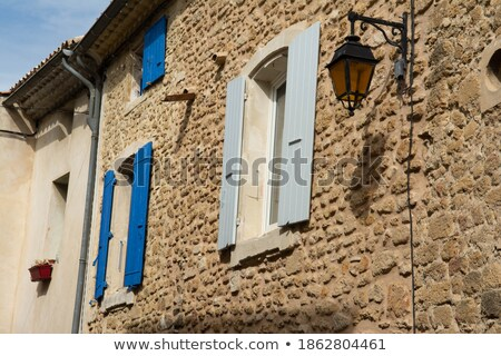 Old stone houses with windows with shutters and canopy Stock photo © bezikus
