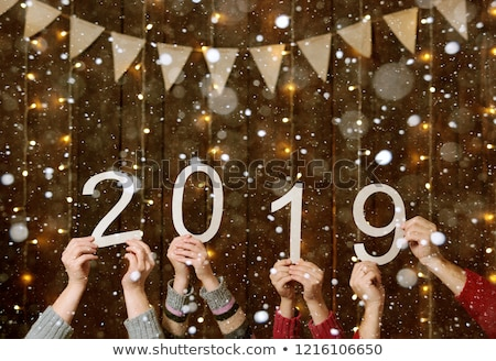 2019 Happy New Year background with shining yellow snowflakes and white frame. Merry Christmas and H Stock photo © olehsvetiukha