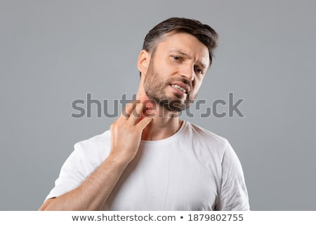 Man Scratching Itch On His Neck Stock photo © AndreyPopov