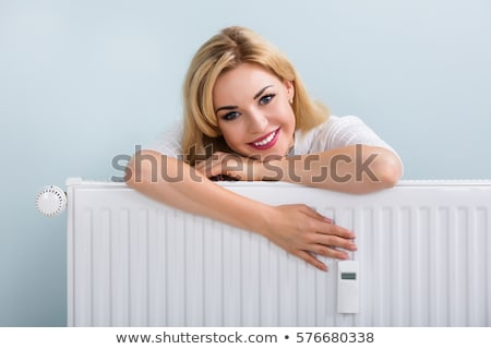 Woman Leaning On Heating Radiator Stock photo © AndreyPopov