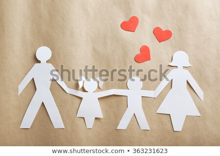 persons hand holding family cut out on red heart stock photo © andreypopov