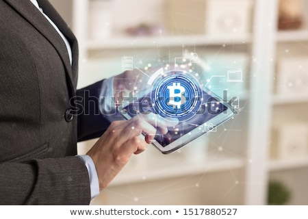 Stock photo: Business woman using tablet in home office mood with bitcoin link network concept