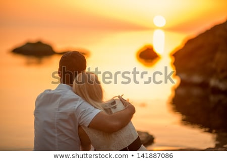 man · zonsondergang · klif · boven · zee - stockfoto © choreograph
