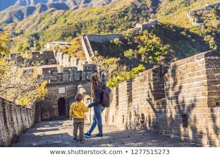 Happy cheerful joyful tourists mom and son at Great Wall of Chin Stock photo © galitskaya