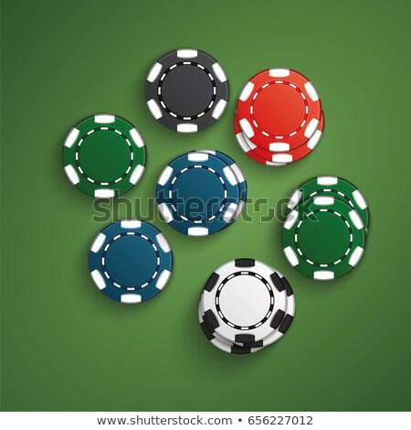 Yeşil poker tablo renkli casino fişi üst Stok fotoğraf © MarySan