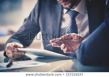Stock photo: Close-up of business man's hands pointing digital tablet into li