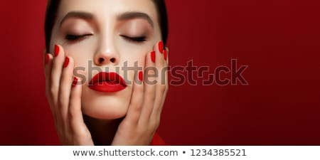 Beautiful woman with red matte lipstick. Beautiful woman face. Makeup detail. Beauty girl with perfe Stock photo © serdechny