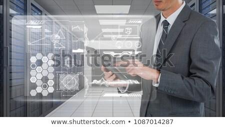 üzletember tart tabletta grafika szerver szoba Stock fotó © wavebreak_media
