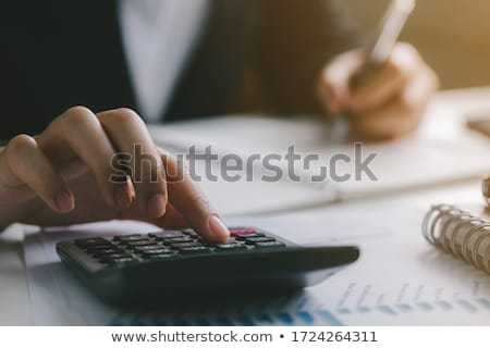 Foto stock: Empresário · calculadora · análise · negócio · investimento · moedas