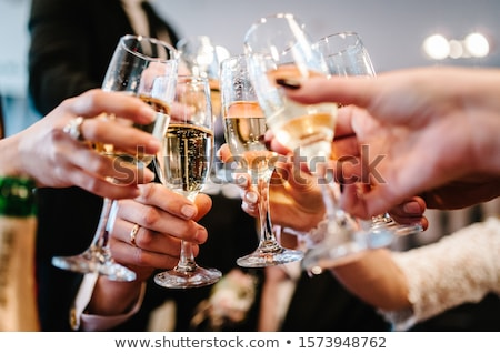 Cheerful friends toasting with flutes of champagne and holding bengal lights Stock photo © pressmaster