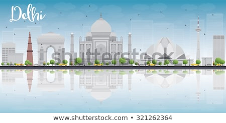 Delhi skyline with grey landmarks, blue sky and reflections Stock photo © ShustrikS