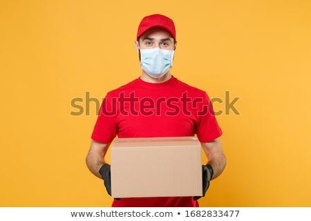 Cardboard box delivery, coronavirus protected delivery person h Stock photo © simazoran