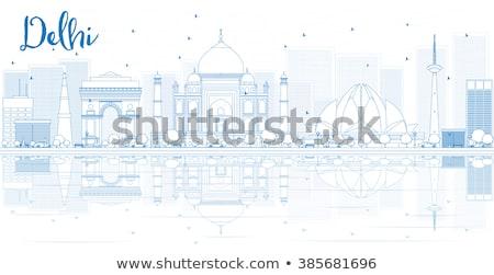 Outline Delhi skyline with blue landmarks.  Stock photo © ShustrikS