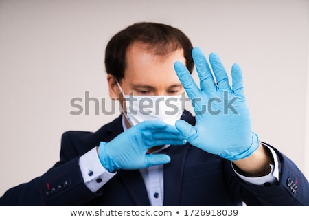 Man In Mask Suffering From Panic Attack Stock photo © AndreyPopov