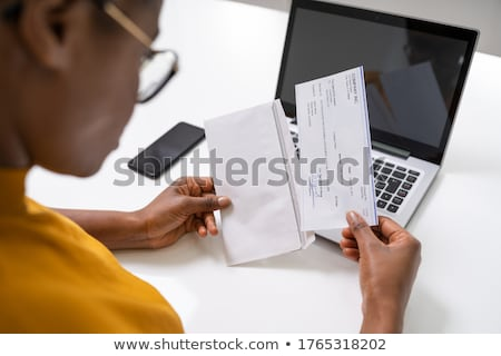 Paycheck Payroll Payment Cheque In Hand Stock photo © AndreyPopov