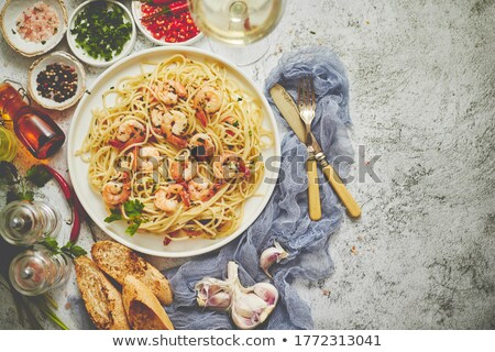 Seafood concept. Pasta with shrimps in a plate, close-up, copy space, top view, flat lay. Stock photo © dash