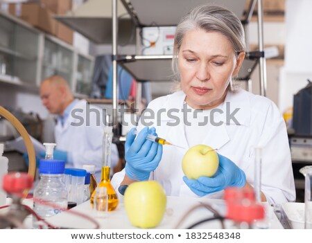 researcher injecting liquid in apple Stock photo © smithore