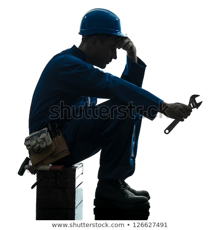 Tired worker holding wrench Stock photo © photography33