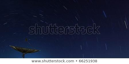 Conceptual Of Big Black Satellite Over Spiral Star Stok fotoğraf © vichie81