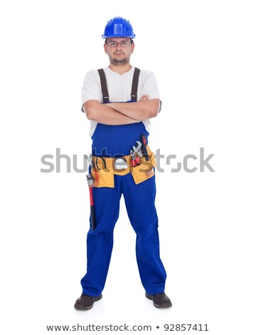 Stock photo: Handyman or construction worker standing with lots of tools