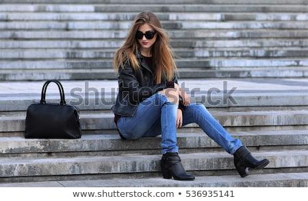 Fashionably dressed young woman in jeans Stock photo © pzaxe