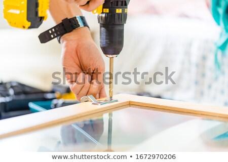 Foto stock: Man Drilling Wood